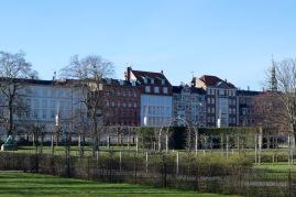 Lovely houses lining park.