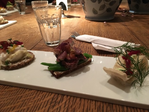 Three sandwiches: cod, thinly sliced steak, and [some other kind of fish]
